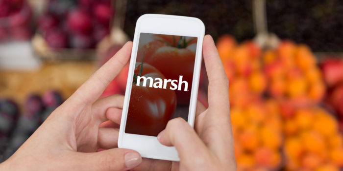 sale, shopping, food, technology and people concept - close up of hands with smartphone taking picture of fruits at street market
